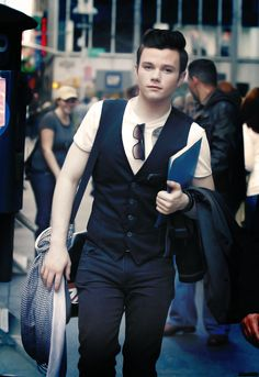 Chris Colfer. J'adore. He makes me want to be a gay boy. I want to have a kid just like him. Amazing in all he stands for. And super adorable to boot.