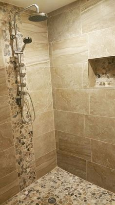 Feeling this warm Zen like shower with warm earth tones of our Pebble Stone Sliced Mixed Tile on floor backsplash and caddy Pebble stone shower ideas Zen shower ideas.