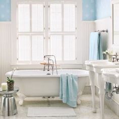 A sparkling white clawfoot tub and porcelain pedestal sinks distinguish this Victorian era bath. | Photo: Alexandra Rowley | thisoldhouse.com