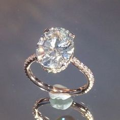 Shown here for the first time, this #rosegold design features a gently sloped pave band that leads up to a perfectly fitted wrap of pave diamonds beneath the 3 carat+ #oval diamond center. The invisible gallery below gives the ring an unmatched airy, open feel especially when combined with the dainty micro-pave band. Style RS-220