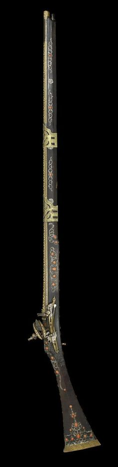 An Ottoman coral-set miquelet Rifle, signed Muhammad Algeria, dated AH 1155/ AD 1742. | ©