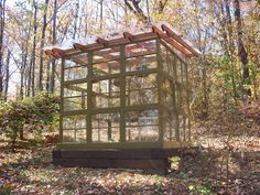 Garden greenhouse made with salvaged wooden framed windows.  Although I'm not in the market to build a freestanding greenhouse, I'm thinking of using this method to attach one to an already existing garden shed.