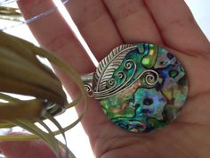 As proud as a Peacock.  Authentic Mother of Pearl and Silver Pendant. $30.00, via Etsy.