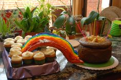 A rainbow party cake. Note to file--make sure the rainbow is supported underneath.