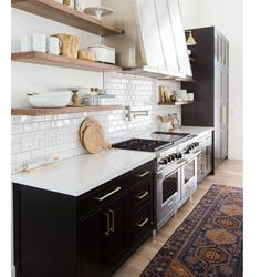 Black Cabinets + White Countertops U0026 Tile + Wood Open Shelving + Brass  Lighting U0026 Fixtures + Vintage Rug In Kitchen