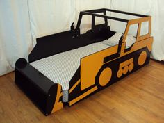 Bulldozer twin bed with cab and footboard/shelf blade