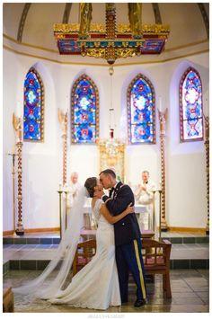 First kiss Cadet Catholic Chapel West Point NY wedding photograph USMA Hudson Valley photo by Jillian Knight Photography