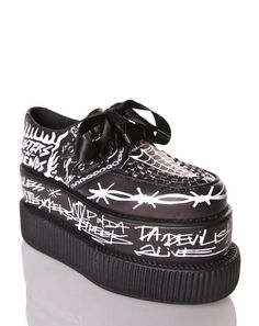 T.U.K. Detention Platform Creepers time to live up to yer bad reputation, bb. These super eXXXclusive creepers feature a sleek black vegan leather construction, double-stacked platform so ya can reach new heights, vegan leather trim with interlaced details on the toe, sikk hand-drawn graphics all over, and classic D-ring satin lace-ups.