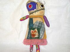 Milly is an original Mystic Hills Ngaroma creation monster doll. She is made with calico and re up-cycled fabric both new and vintage. She has vintage button eyes and a hand embroidered and appliqued face. Her face has also been stained and tinted