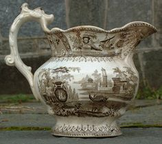 Google Image Result for http://images.oneofakindantiques.com/2671_antique_porcelain_water_pitcher_1.jpg