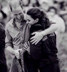 July 4, 2011 - Prince William, Duke of Cambridge hugs his wife Catherine, Duchess of Cambridge after the team he rowed in won a Dragon boat race, in which they competed against each other, across the Dalvay lake.