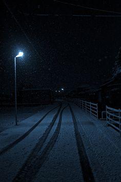 Snowy night under a street light