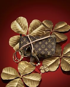 Four-leaf clovers and a few key Louis Vuitton accessories will be sure to get Lady Luck on your side this holiday season.