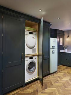Utility cupboard hidden in a kitchen cupboard! So clever!