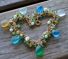 I would love to find these sea glass beads!  Sea Glass Multicolor Bracelet by OceanCharmsSeaGlass on Etsy