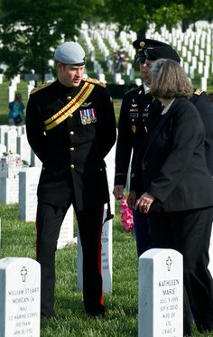 Prince Harry Photos - Prince Harry Visits Arlington National Cemetery - Harry speaks with the mother of a soldier buried in Section 60, where most of the Afghanistan soldiers are buried.