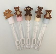 A perfect favor for a Teddy Bears Picnic, Teddy Bear party, Teddy Bear baby shower or 1st birthday party. These Teddy Bear Bubble wands are approx 4 inches long and 7/16 inch diameter. They contain approx. 0.14 fl oz of bubble mixture. The bubble wands come finished with your choice of ribbon trim - illustrated in the picture is pale pink, pale blue, ivory, natural jute or white. If you would like something different please let us know and if we can we will make it for you. Please select...