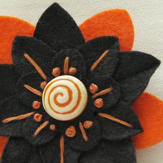 Halloween felt flower pin with vintage swirly button.