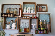 in the kitchen, wood drawers repurposed as wall shelving