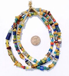 These are authentic old antique mixed African Trade beads from Ghana West Africa. These pieces were then hand strung.  Color : Multi  Approximate #of beads: 184  Bead size: 1-11 x 3-11.5mm  33 inches long necklace  Hole size: 1-4mm