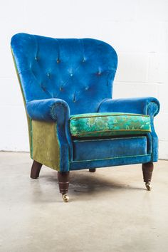 Blue velvet chair, lashing & lashings of blue velvet, with olives & teals, & family signatures embroidered on sides & seat base