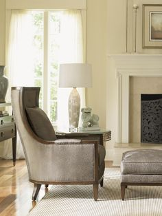 This modern take on the classic wing chair is a polished accent piece you're sure to love. The chair sits proudly with its tall silhouette, boasting the sophisticated look of button tufting and exposed wood trim. Premium seating comfort is provided by a resilient and durable foam seat cushion, wrapped in blended feathers and down.