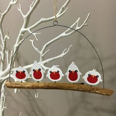 5 white robins on a branch.Hanging Christmas decoration.Shoeless joe.Shabby chic