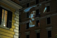 Rome, Italy A feature film is projected on the facade of a building to entertain confined residents Drive In Cinema, Staten Island Ferry, Lights Artist, Free Films, Film Industry, Feature Film, The Guardian, Amazing Photography, Summer Time