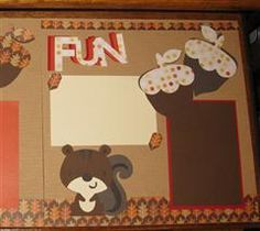 Using the new Cricut Create a Critter 2 cartridge samples I created a fun fall scrapbook 12x12 double page layout.  Since I can only print on a 6x12 mat, I played around with the sizes of the tree, squirrel, acorns and words.  I then picked patterned paper to create a layout that would flow with the fall theme.