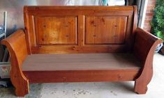 Repurposed queen size wood sleigh bed into a bench. Seat boards are painted with brown chalk paint. Antique Oil Finish on the rest of the bench. Primitive decor