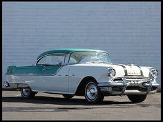 1955 Pontiac Starchief Hardtop 287/200 HP, Automatic     Had a rust and cream one in 1957
