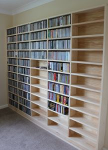 Are you looking for a way to store a large collection of DVDs that's organized, efficient, and doesn't take up a lot of space? Here are 7 smart DVD storage ideas that you'll find useful! Dvd Storage Cabinet, Dvd Storage Boxes, Movie Storage, Craft Storage, Storage Spaces, Storage Ideas, Storage Solutions, Movie Shelf, Home Libraries