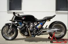 This lovely cafe racer was constructed in Australia. This Honda cafe racer is known as the LeatherHead you can most likely guess why. Street Fighter Motorcycle, Futuristic Motorcycle, Cafe Racer Honda, Drag Bike, Speed Bike, Triumph Bobber, Honda Motorcycles, Honda Cbx, Stunt Bike