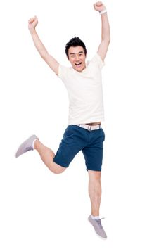 Stock Photo : Cheerful young man jumping