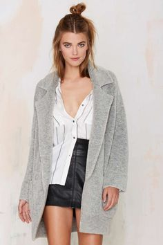 How often do you get the best of both worlds? The Madeline Coatigan is part coat & part cardigan, made in chunky gray wool.