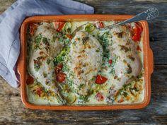 Parmesanbakt kyliing med urter, tomat og fløte