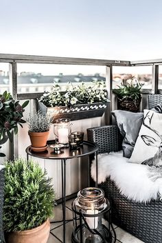 small balcony. outdoor seat + fur throw