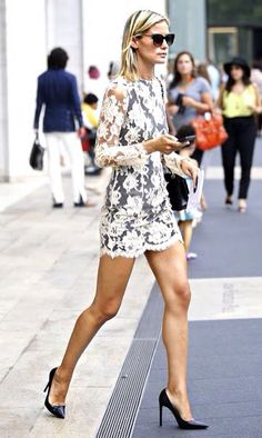 Street style in short lace dress and umps showing off hot legs