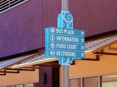 A light pole mounted directional sign helps brand each court's color while offering directional information to the passing shoppers.