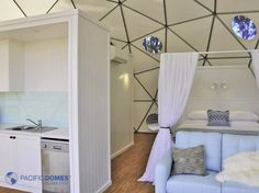 Bedroom and the sink in the kitchen in a 20 ft dome in Australia.