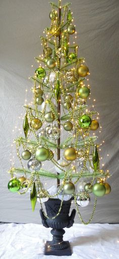 Green Goose Feather Christmas Tree with Cast Iron Urn by Efeeks, $600.00