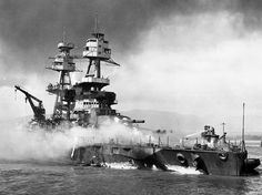 The battleship Nevada (BB 36) burns in the aftermath of the Japanese attack on Pearl Harbor. (U.S. Navy) #