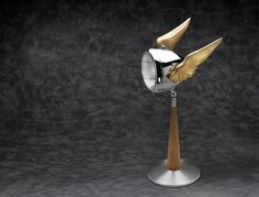 Original 1950's fully restored Mercury lamp. This rare and elegant collector's quality lamp is custom made from an original chrome headlight of the Mercury motorcycle with adjustable, gold-plated alum