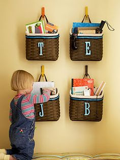 I love this idea for keeping track of their library books!  Just have to figure out where to hang them.