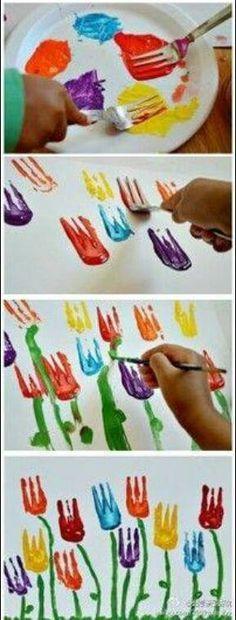 Super simpel! Gewoon een vork nemen, die in de verf dippen en tulpjes maken op papier.