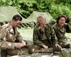 """#WW2ColourisedPhotos ...... Lieutenant Colonel Anna """"Tony"""" Walker Wilson, Women's Army Corps (WAC) Staff Director in the European Theatre of Operations, sits in the shade of a tree with a fellow WAC and US Army Technical Sergeant, probably in the grounds of Château du Pont-Rilly, France, 1st of August 1944."""