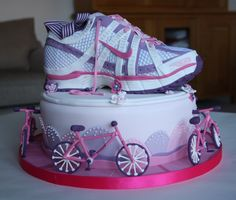 I made this ladies running shoe / trainer cake for my friend's 40th birthday. It is all edible, even the bicycles! The cake is based on my Nike Air Pegasus trainers, with the colours changed to pink, purple and white (and not covered in mud!). Biggest compliment was when a couple of people at the party asked me if it was a real trainer. Running and cakes. Two of my favourite things :-)
