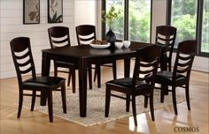 "7 pc Cosmos collection espresso finish wood dining table set with leather like vinyl upholstery on the seats. This set includes the table with thick tapered legs and 6 side chairs upholstered in a leather like vinyl seat and curved horizontal slats on the chair backs. Table measures 40"" x 72"" X 30"" H. Some assembly required. SKU 	Cosmos"