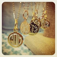 Monogrammed golden necklace pendants.