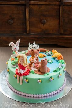 Children's fondant cake with animals and fondant figures. Girl with a cupcake, bears on a romantic picnic and animals around the lake. :)